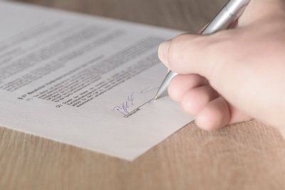 HRMS contract - man signing contract