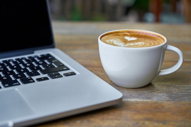 time and attendance for remote workers - computer and coffee