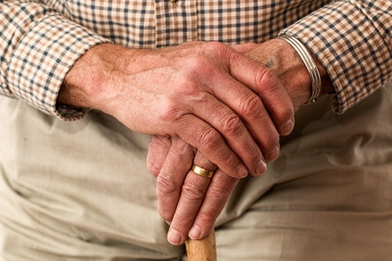 HRMS benefits for retirees - old man with stick