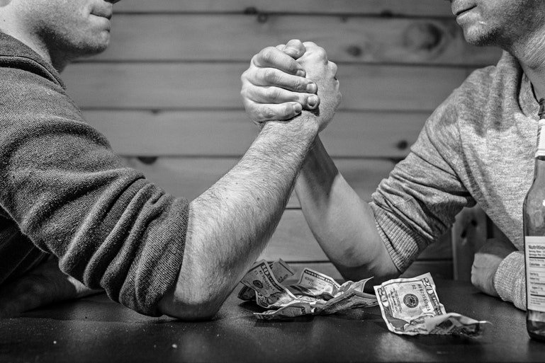 bamboohr vs zenefits - men arm wrestling